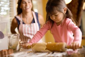 Mom and little girl baking