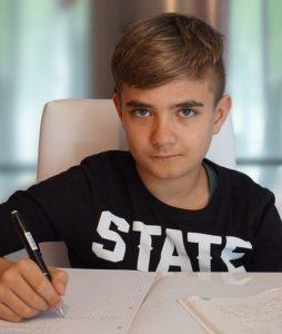 middle school boy doing schoolwork