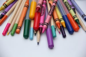 Homeschool supplies of crayons, pens, and markers
