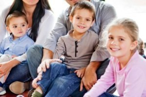 Homeschooling Multiple Ages, seated family with multiple aged children