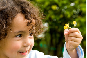Potty training toddlers while homeschooling, small child with flower image