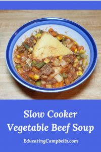 Bowl of slow cooker vegetable beef soup - pinterest image