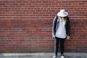 My Biggest Homeschool Mistake, woman leaning against brick wall with her head down
