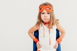 Reasons Not to Homeschool, little girl in a superhero costume with attitude