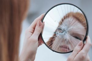 Reasons Not to Homeschool, woman looking into broken mirror