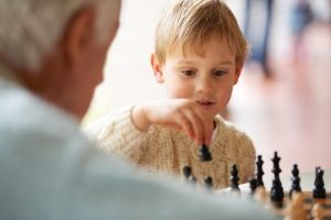 When Your Family is Anti-Homeschooling, child playing chess with grandpa