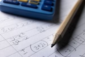 Favorite Free Homeschool Curriculum, math problems with calculator and pencil