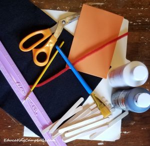 supplies to make snowman popsicle stick ornament