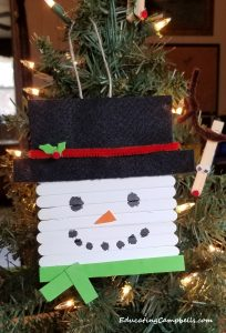 snowman popsicle stick ornament on christmas tree