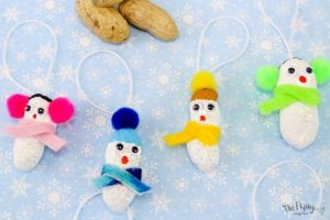 christmas ornament for kids, painted peanut shell with faces and winter gear