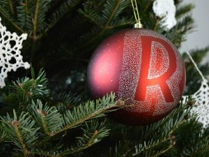 personalized christmas tree ornament with reverse letter coloring on red ornament