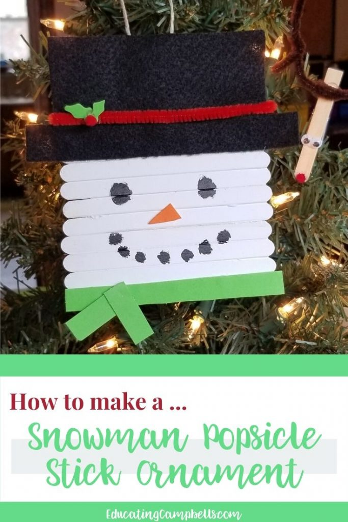 pinterest image of snowman popsicle stick ornament with text overlay
