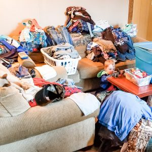 kid's clothes organization, clothes in piles