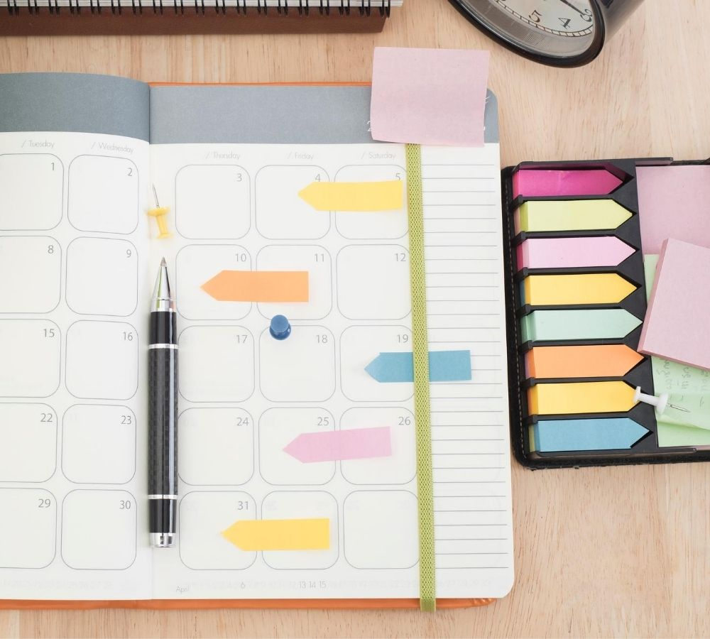 simple homeschool planning image, calendar, pens, sticky notes