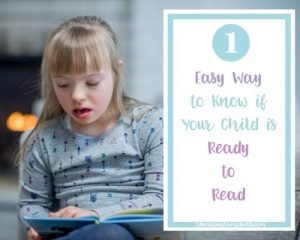 one way to know if your child is ready to read, girl looking at a book