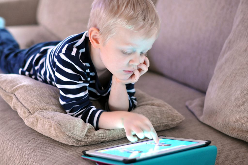 image for How to Choose an Effective Reading Curriculum -- boy playing tablet